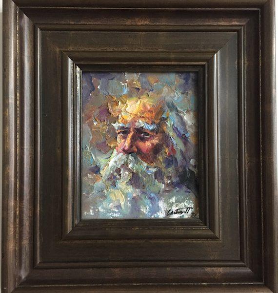 bearded man painting